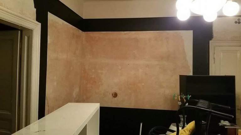 Living room black wall frames gamanacasa